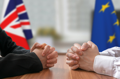Negotiation of Great Britain and European Union (Brexit). Statesman or politicians with clasped hands.